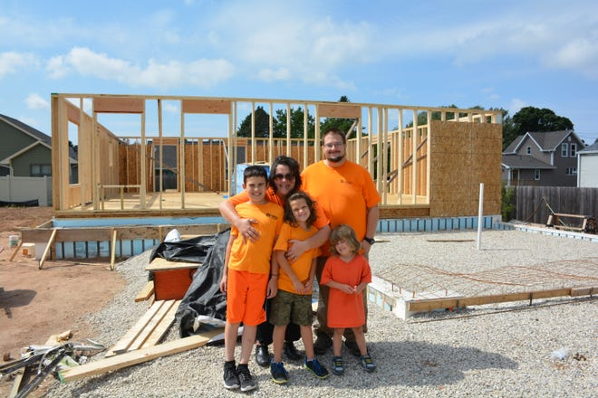 The walls are going up and the Purdy family is ecstatic. Jack, left, Alaina and Jordyn pose with their parents, Amanda and Jack, back row. Alexis and Ethan were unavailable for the photo Aug. 31, 2018.