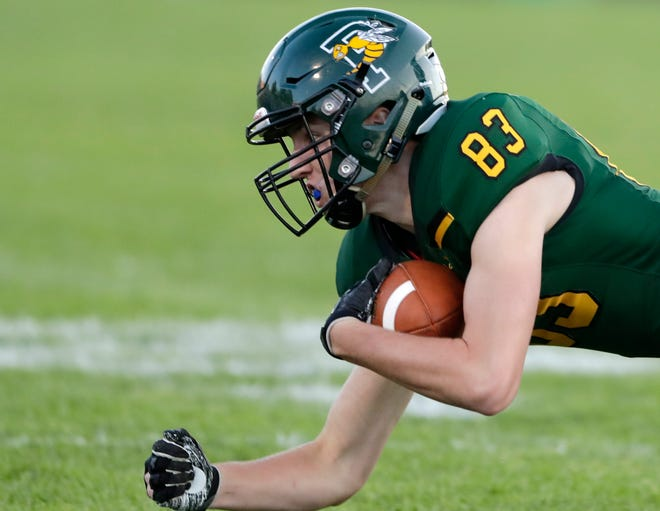 Green Bay Preble's Nick Renier (83) catches a pass as Green Bay Southwest's Jake White (7) defends in a FRCC football game at Preble high school on Thursday, August 30, 2018 in Green Bay, Wis.