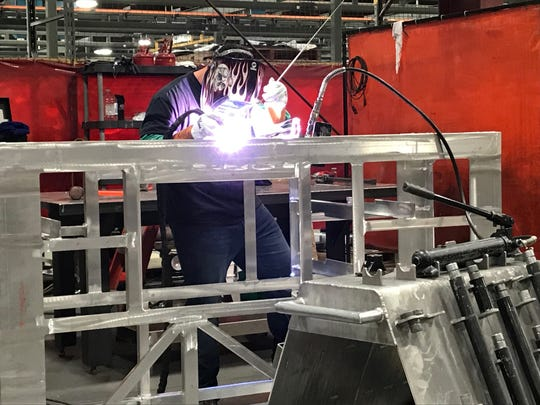 A welder works on the shop floor Aug. 27 at Fox Valley Metal-Tech in Ashwaubenon.