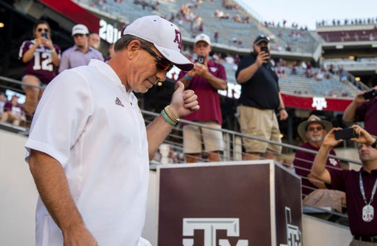 Texas A&M head coach Jimbo Fisher gives a Gig'Em to fans during warmups of an NCAA college football game against Northwestern State Thursday, Aug. 30, 2018, in College Station, Texas. (AP Photo/Sam Craft)