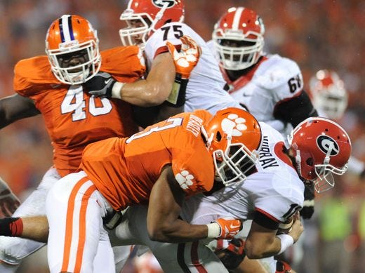Clemson's Vic Beasley (3) sacks Georgia quarterback Aaron Murray during the 2013 game.