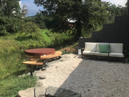 "The patio area of Jaime and Candice Henderson's hobbit house featured on HGTV's ""Tiny Paradise."""