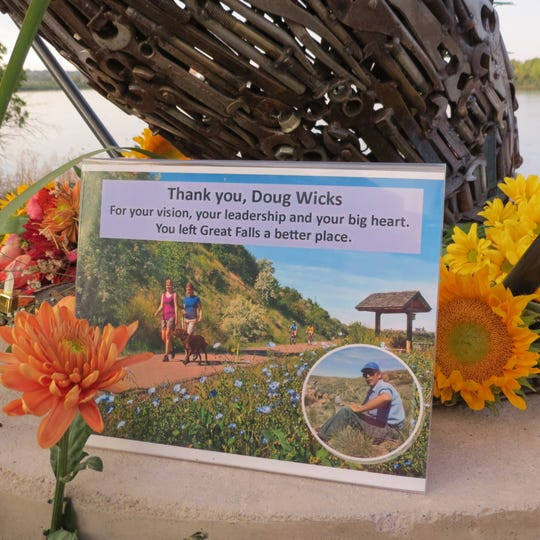"""""""Thank you, Doug Wicks. For your vision, your leadership and your big heart. You left Great Falls a better place"""" reads a sign at a pelican sculpture dedicated to him along the River's Edge Trail."""