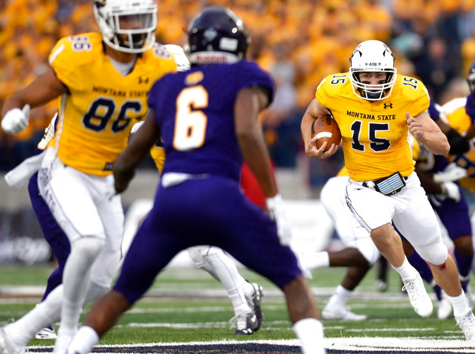 Montana State quarterback Troy Andersen, right, escapes for a run during the Gold Rush during an NCAA college football game on Thursday, Aug. 30, 2018, at Bobcat Stadium.
