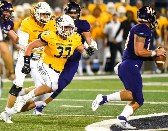 Montana State defensive end Bryce Sterk makes a run at Western Illinois' Sean McGuire for a sack during an NCAA college football game, Thursday, Aug. 30, 2018, at Bobcat Stadium.