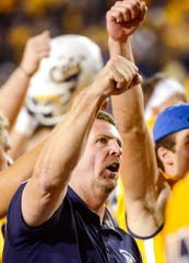 Montana State head coach Jeff Choate celebrates their win over Western Illinois during an NCAA college football game at Bobcat Stadium, Thursday, Aug. 30, 2018, in Bozeman, Mont.