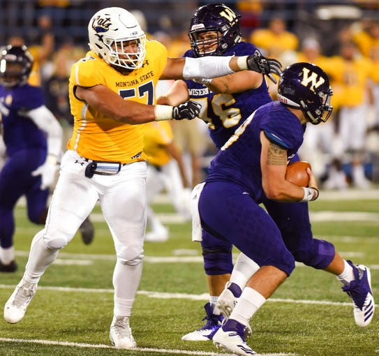 Montana State defensive end Tyrone Fa'anono, left, tries to push past Western Illinois' Drew Wagner to get to quarterback Sean McGuire during an NCAA college football game at Bobcat Stadium, Thursday, Aug. 30, 2018, in Bozeman, Mont.
