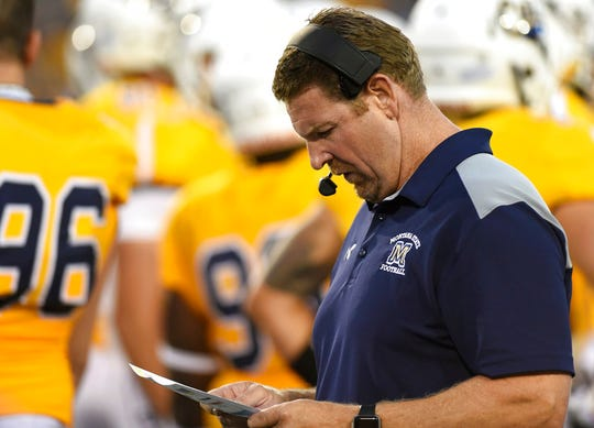 Montana State head coach Jeff Choate plans his next play during an early-season game against Western Illinois Bobcat Stadium.