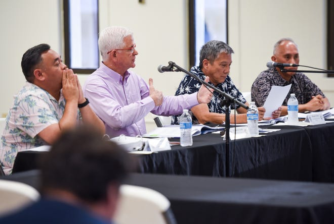Guam Election Commission member Patrick Civille, second from left, explains the calculation method used to determine whether or not a mandatory recount of Primary Election ballots were required, during a commission meeting in Hagåtña on Thursday evening, Aug. 30, 2018.