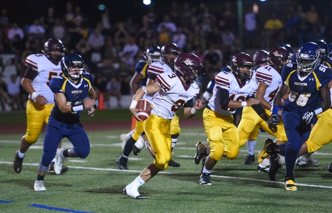 In this Aug. 31 file photo, Father Duenas running back Kein Artero sprints by the Panthers defense during an IIAAG High School Football game at the Guam High.