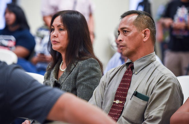 Democrat gubernatorial team, Sen. Frank Aguon Jr., right, and Alicia Limtiaco, listen to Guam Election Commission members discuss the calculation method used to determine whether or not a mandatory recount of Primary Election ballots were required, during a meeting in Hagåtña on Thursday evening, Aug. 30, 2018.