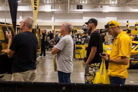 Fans wait in a line for autographs during the tenth annual FRYfest on Friday, Aug. 31, 2018, inside the Marriott in Coralville along the Iowa River Landing.