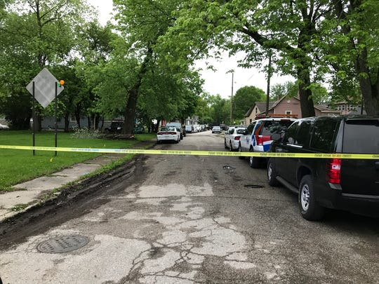 Indianapolis Metropolitan Police officers secure the scene of a fatal shooting May 11, 2017.