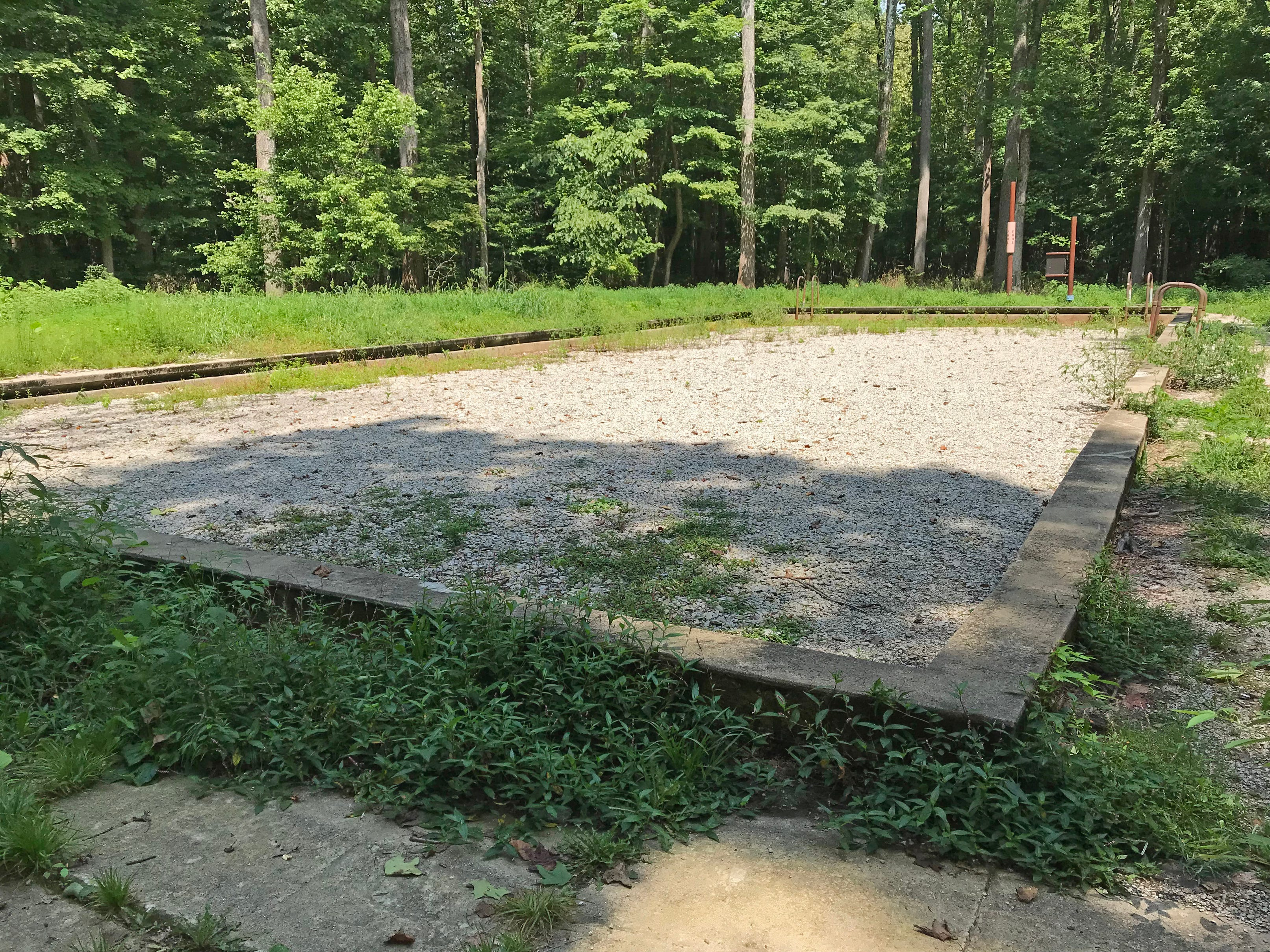 When the Indiana Department of Natural Resources took over Rose Island, the pool was filled with stagnant water and a breeding ground for mosquitos. A filter was installed and filled in with gravel,.