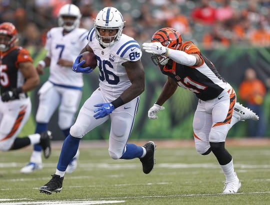 Indianapolis Colts tight end Erik Swoope (86) runs by Cincinnati Bengals defensive back Trayvon Henderson (41) in the first half of their preseason football game at Paul Brown Stadium in Cincinnati, OH. on Thursday, Aug. 30, 2018.