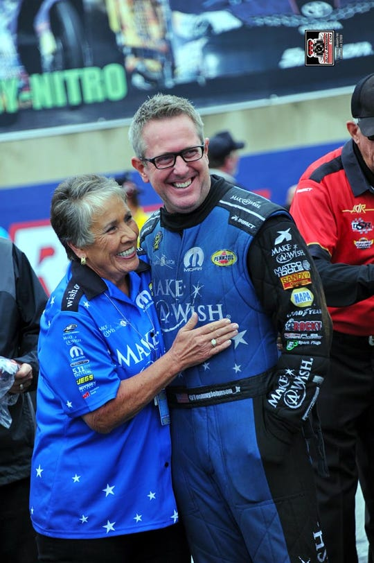Terry Chandler, left, with driver Tommy Johnson Jr.