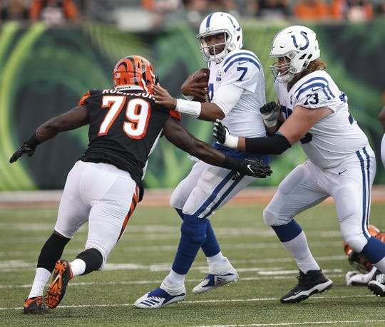 Indianapolis Colts quarterback Jacoby Brissett (7) avoids the sack attempt by Cincinnati Bengals defensive tackle Simeyon Robinson (79) in the first half of their preseason football game at Paul Brown Stadium in Cincinnati, OH. on Thursday, Aug. 30, 2018.