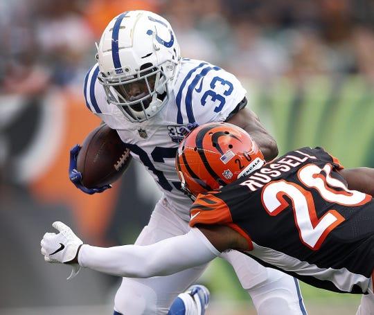 Indianapolis Colts running back Robert Turbin (33) runs into Cincinnati Bengals cornerback KeiVarae Russell (20) in the first half of their preseason football game at Paul Brown Stadium in Cincinnati, OH. on Thursday, Aug. 30, 2018.