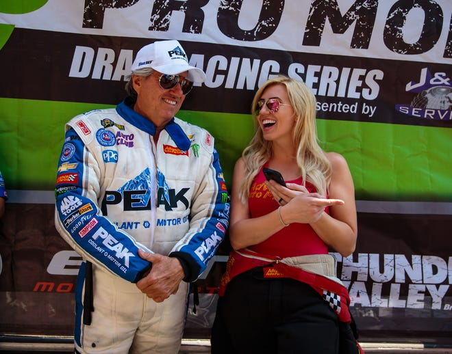 NHRA funny car drivers John Force and his daughter Courtney Force talked during the Thunder Valley Nationals at Bristol Dragway in Tennessee on June 17, 2018.