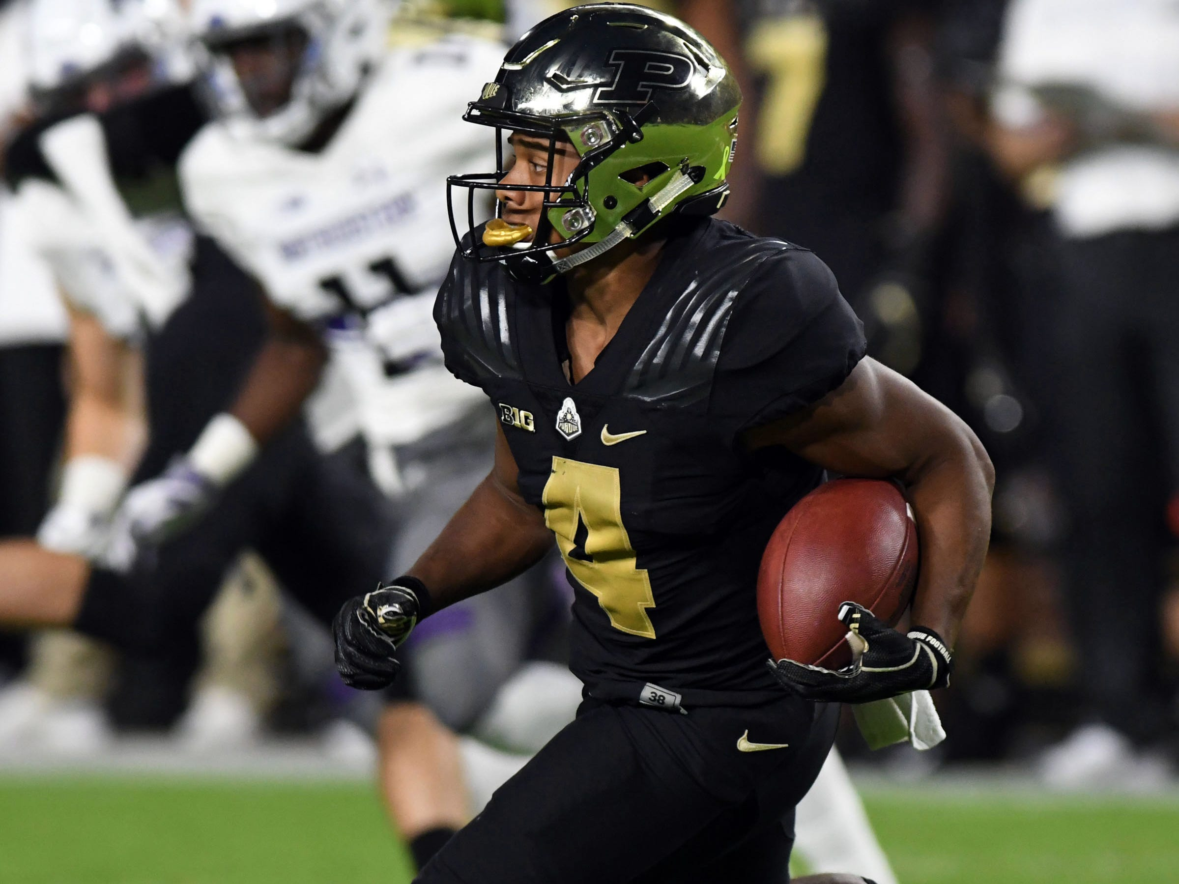 Aug 30, 2018;  Purdue Boilermaker receiver Rondale Moore (4) runs back a kick off in the first half against the Northwestern Wildcats at Ross-Ade Stadium.