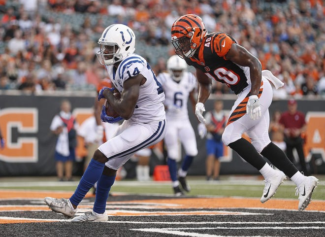 Indianapolis Colts wide receiver Zach Pascal (14) catches a touchdown pass behind Cincinnati Bengals defensive back Brandon Wilson (40) in the first half of their preseason football game at Paul Brown Stadium in Cincinnati, OH. on Thursday, Aug. 30, 2018.
