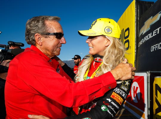 NHRA team owner Don Schumacher, shown with driver Leah Pritchett, and his drivers visit Riley's Hospital for Children in the lead-up to the U.S. Nationals.