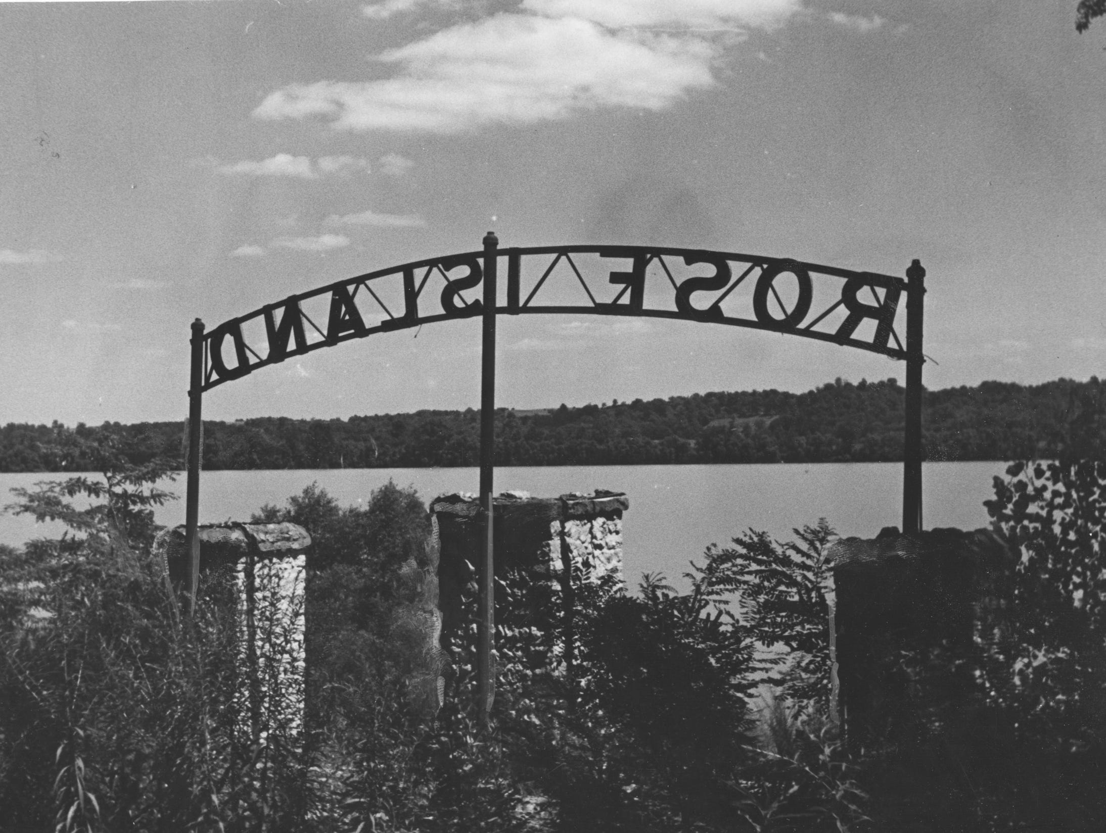 Weeds grow all around the gates of Rose Island, once popular but now abandoned just two years after the food of 1937. Sept. 10, 1939