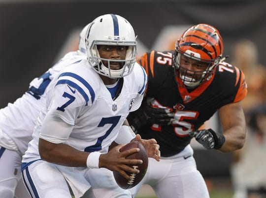 Indianapolis Colts quarterback Jacoby Brissett (7) runs away from Cincinnati Bengals defensive end Jordan Willis (75) in the first half of their preseason football game at Paul Brown Stadium in Cincinnati, OH. on Thursday, Aug. 30, 2018.