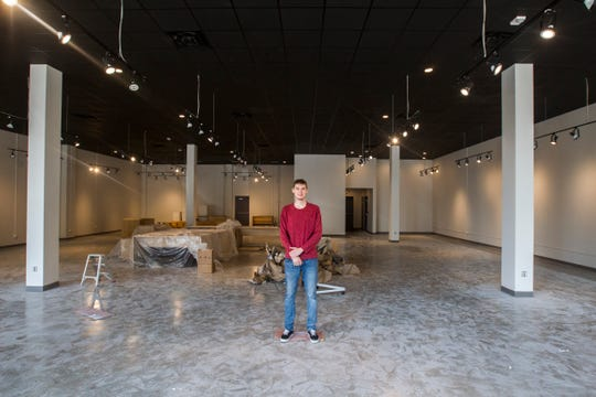 Patrick Hagan, of Foundry IRL, gives a tour of a new space that will be home to startups on Friday, Aug. 31, 2018, in the Iowa River Landing in Coralville.