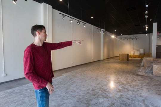Patrick Hagan gives a tour of a new space that will be home to startups on Friday, Aug. 31, 2018, in the Iowa River Landing in Coralville.