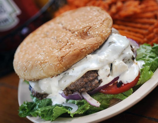 The Greek Burger from Kristos in Madison features a creamy feta cheese sauce.