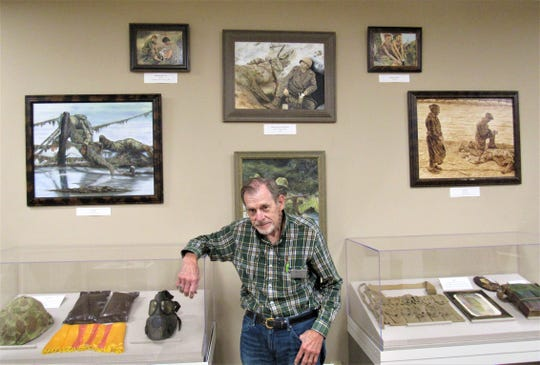 Farragut Museum committee member and docent Steve Stow shows some of the paintings by Alexander Dumas now on display.