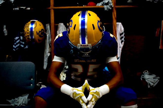 Gatlinburg-Pittman's Trevon Faulkner (25) takes a silent moment in the locker room during a football game between Gatlinburg-Pittman and Northview at Gatlinburg-Pittman High School in Gatlinburg, Tennessee on Thursday, August 30, 2018.