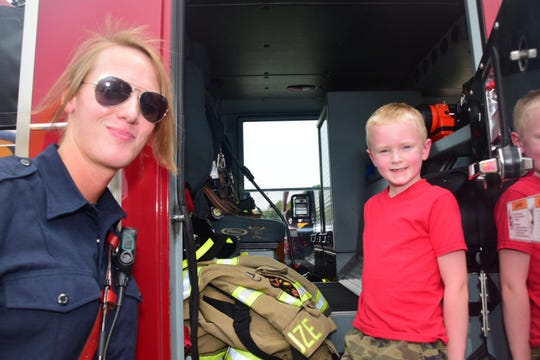 Andrew Lauer with the Karns Fire Department gives Elija Douglas, 7, a tour of the fire engine at the Back to School Bash held at Beaver Creek Dental Saturday, Aug. 25, 2018.