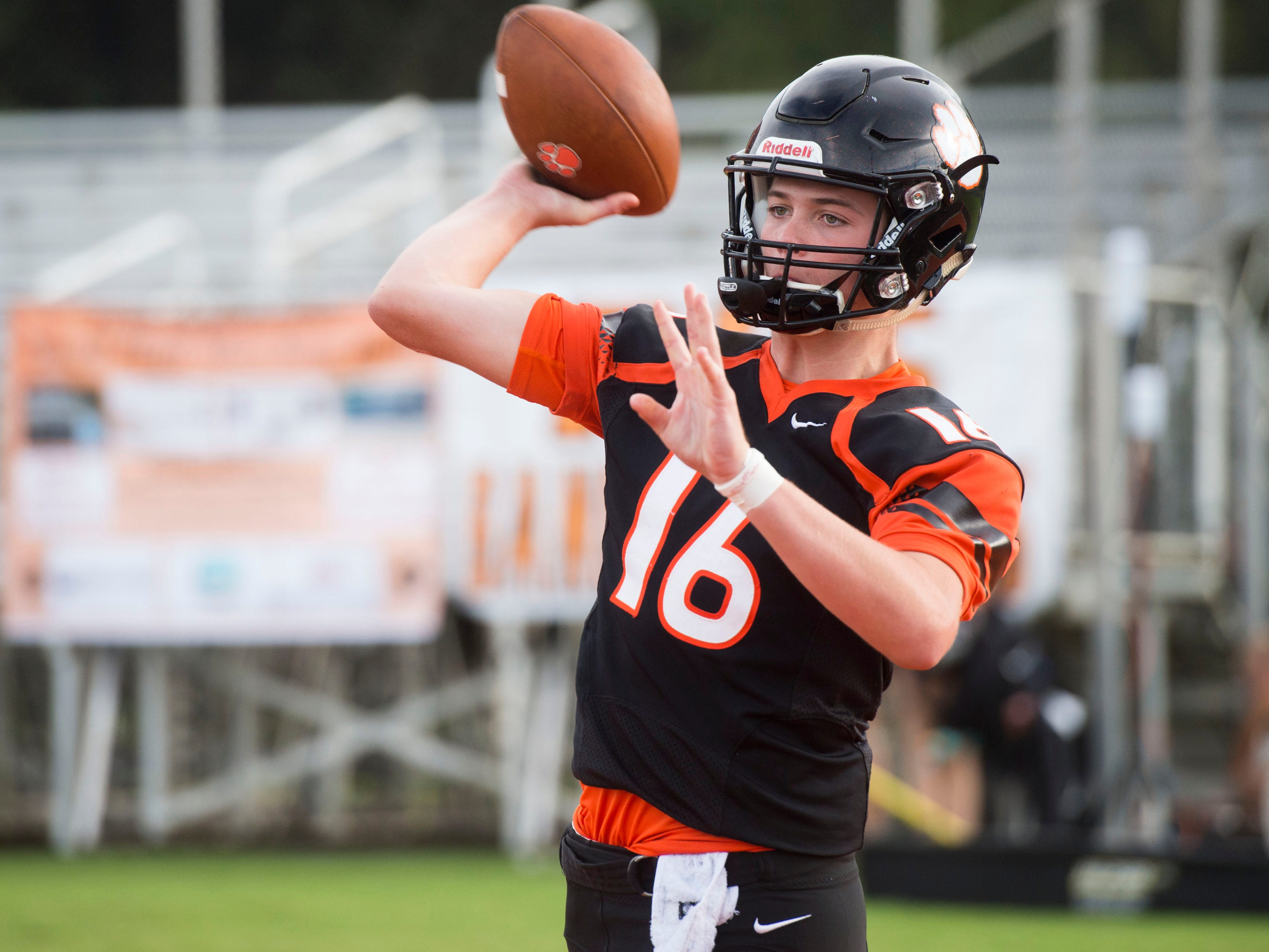 Powell's Walker Trusley (16) warms up before the start of the football game against Fulton on Friday, August 31, 2018.