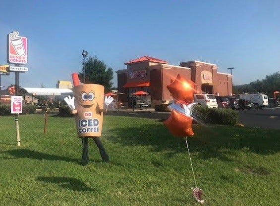 The Iced Coffee Man greets guests at the new Dunkin' Donuts on Chapman Highway. August 2018