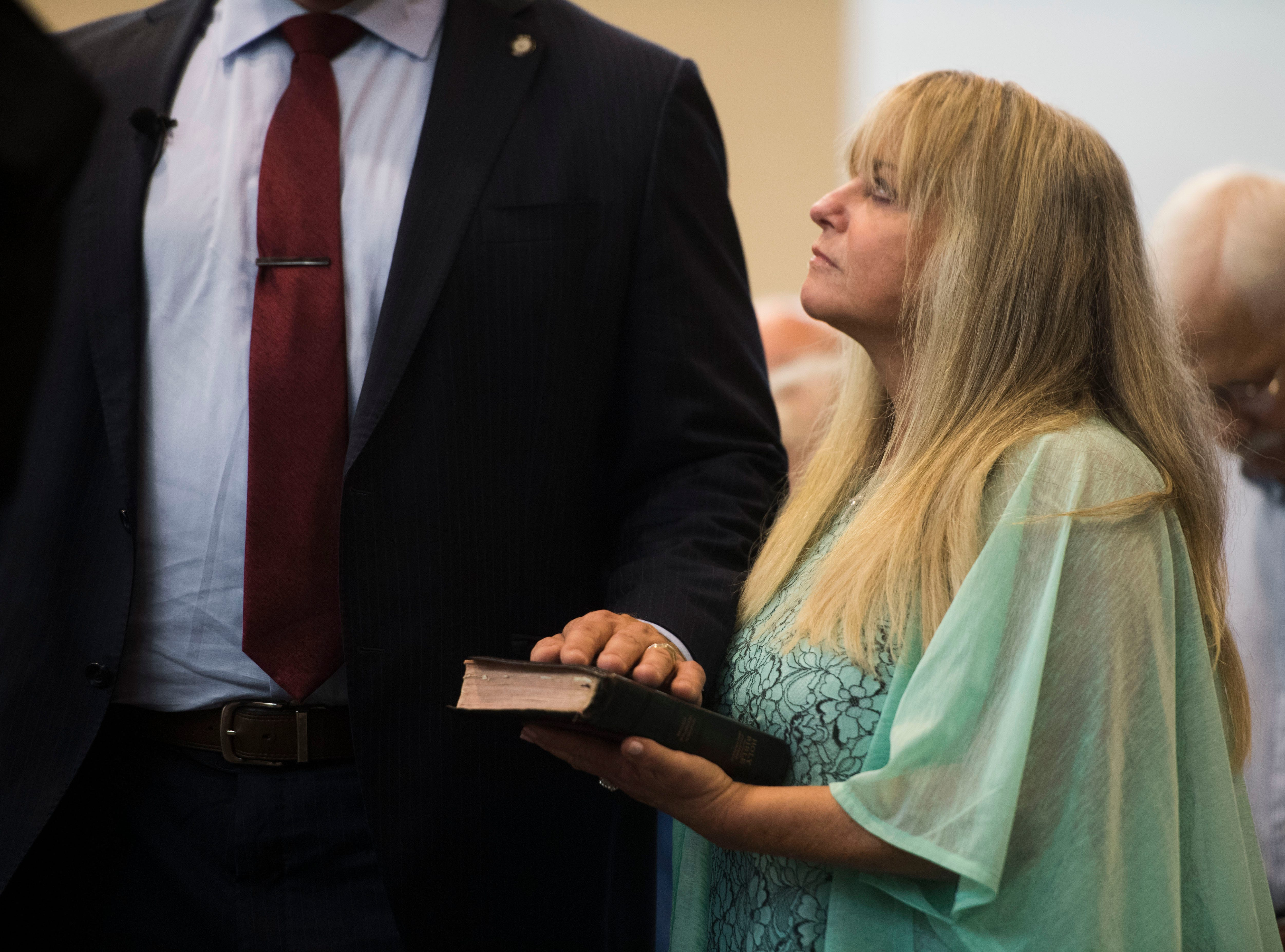 Glenn Jacobs takes the oath of office as Knox County Mayor as his wife Crystal watches in the Main Assembly Room of the City County Building Friday Aug. 31, 2018.