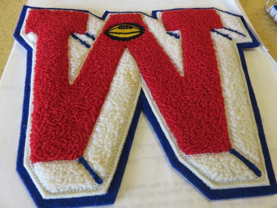 """An old West """"W"""" football letter belonging to Paul Bankston."""