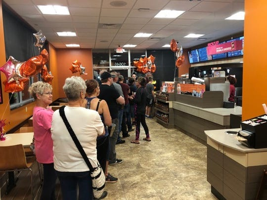 Eager customers formed a line to welcome Dunkin' Donuts to Chapman Highway. August 2018