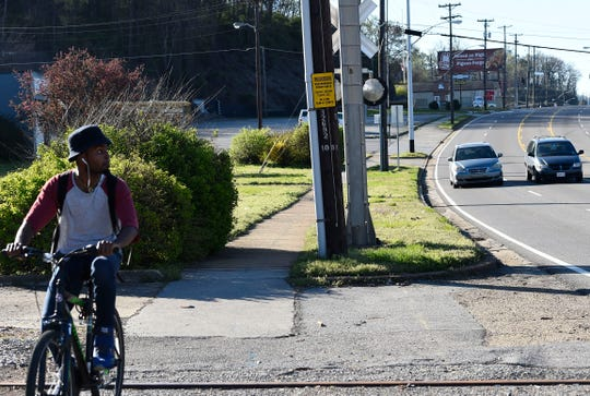 University of Tennessee student Christopher Allen bikes to campus by way of Chapman Highway Wednesday, April 1, 2015. (AMY SMOTHERMAN BURGESS/NEWS SENTINEL)