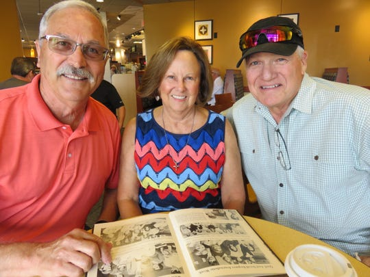Rick Benson, Sherry Black Walsh and Paul Bankston take a break from reminiscing about the old days at West High in 1968. The class is planning a 50-year reunion for late September.
