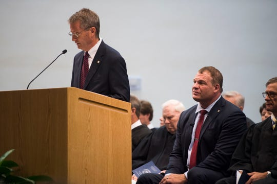 Former Knox County Mayor Tim Burchett speaks as new Knox County Mayor Glenn Jacobs listens, in the Main Assembly Room of the City County Building Friday Aug. 31, 2018.