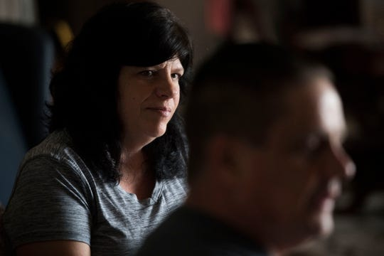Sheri Delaney looks toward her husband as he speaks about his experience being abused as a child by the priest at his childhood church in Philadelphia, in their Sevierville, Tenn., home Thursday, Aug. 30, 2018.
