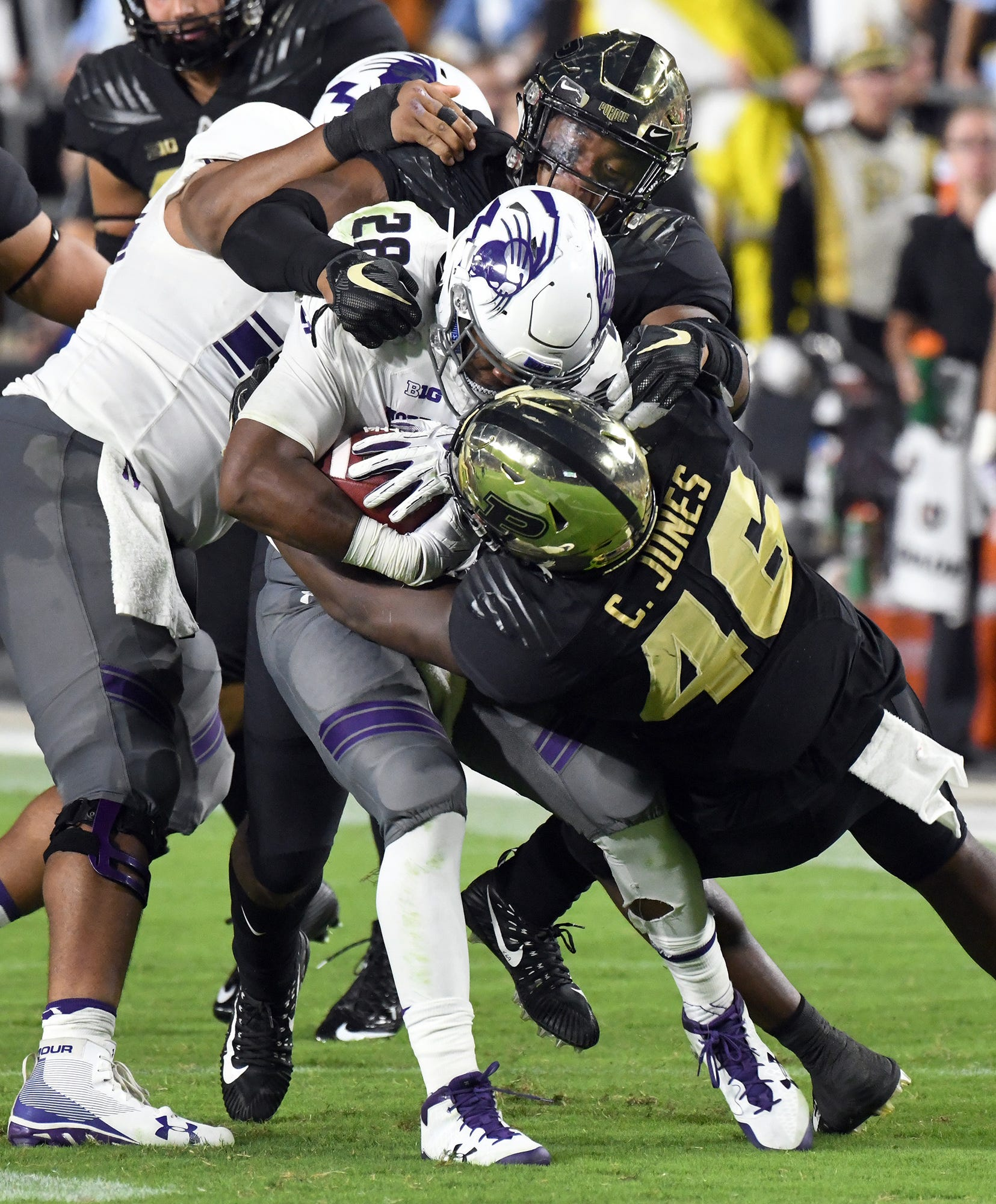 The Purdue defense wraps up Jeremy Larkin of Northwestern Thursday, August 30, 2018, at Ross-Ade Stadium. Purdue fell to Northwestern 31-27.