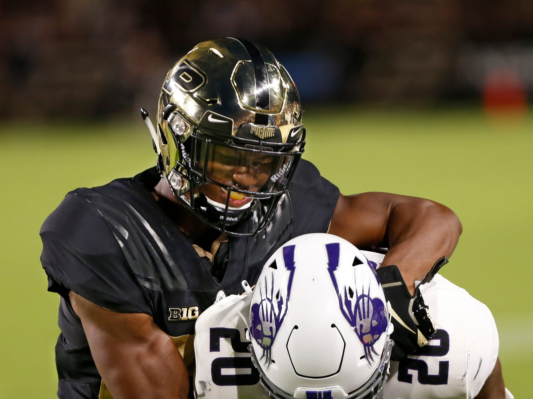 Navon Mosley of Purdue tackles John Moten IV of Northwestern in the second quarter Thursday, August 30, 2018, in West Lafayette.