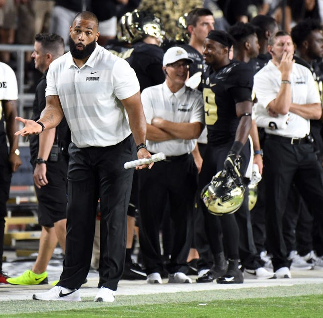 The Purdue bench react to a call that goes against the Boilermakers in the second half against Northwestern Thursday, August 30, 2018, at Ross-Ade Stadium. Purdue fell to Northwestern 31-27.