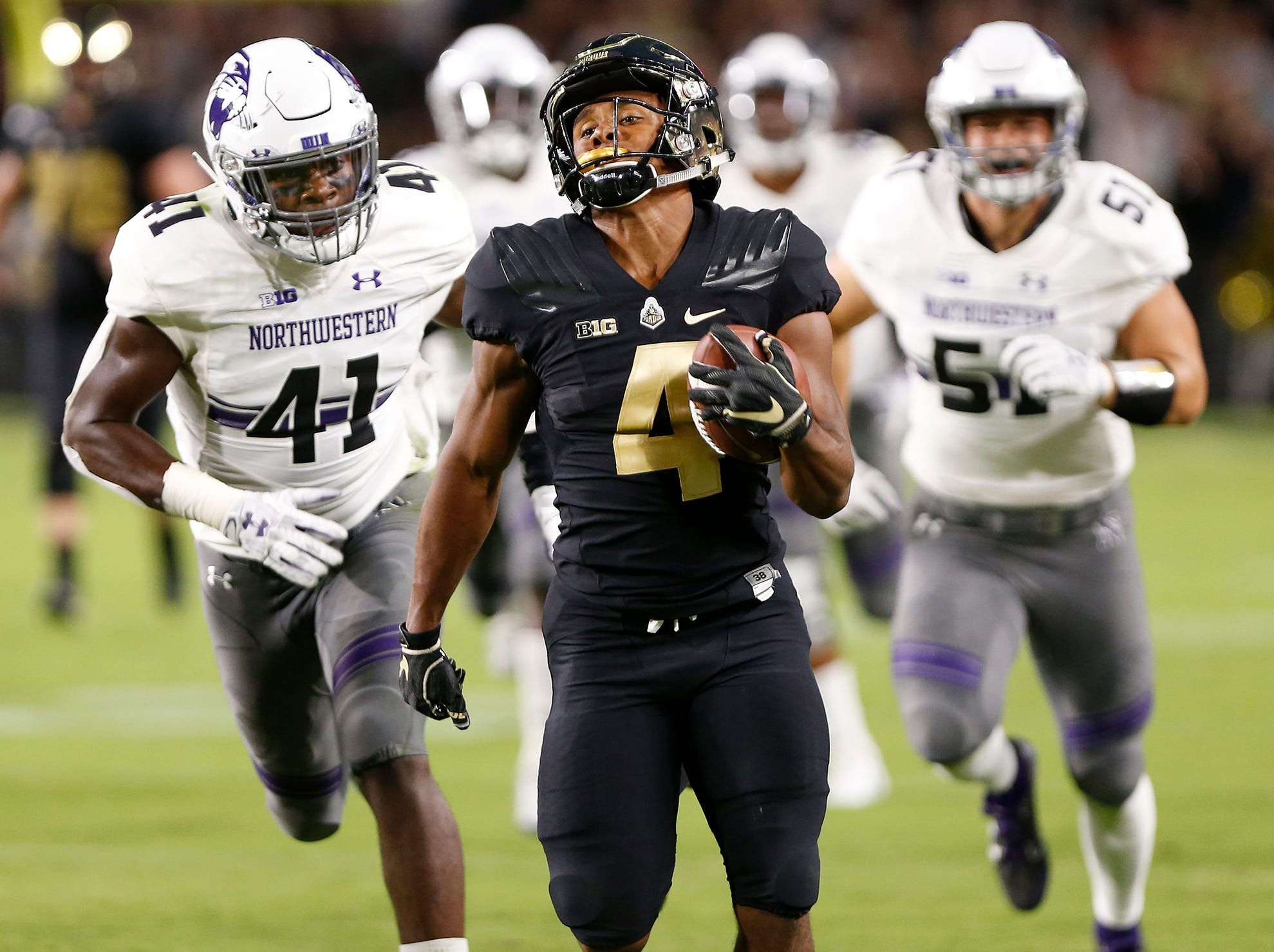Rondale Moore of Purdue on a 76-yard touchdown run at 1:02 in the first quarter against Northwestern Thursday, August 30, 2018, in West Lafayette. Moore's score tied the game at 14-14.