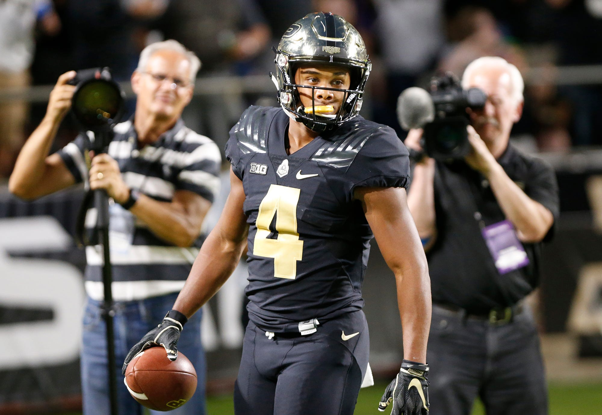 Rondale Moore looks to the Purdue bench after at 76-yard touchdown run at 1:02 against Northwestern Thursday, August 30, 2018, in West Lafayette. Moore's score tied the game at 14-14.