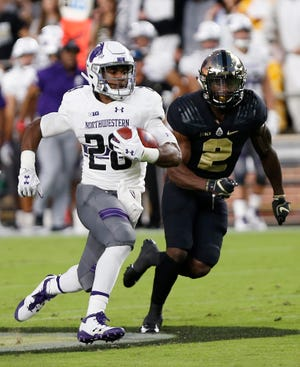 Jeremy Larkin of Northwestern is chased by Kenneth Major of Purdue in the first quarter Thursday, August 30, 2018, in West Lafayette. Northwestern defeated Purdue 31-27.