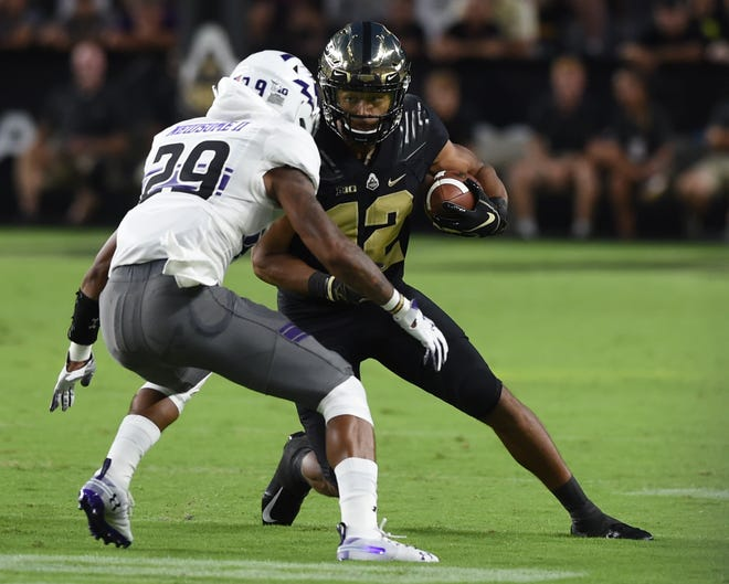 Purdue wide receiver Jared Sparks (12) seeks to add a second victory and family bragging rights over brother Adam Sparks of Missouri.